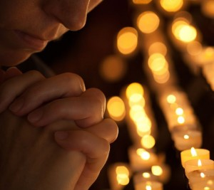 2014_03_apology_man_praying_candle_Image credit a href 123rf.comphoto_16569421_woman-praying-in-church-cropped-part-of-face-and-hands-closeup-portrait.html'andreykuzmin  123R